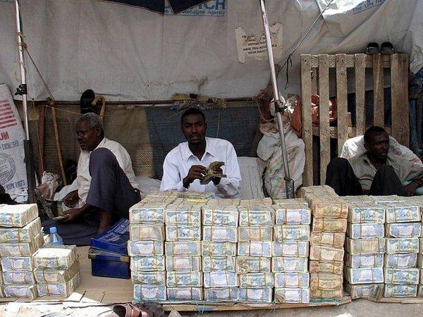Деньги в африке герб суджи